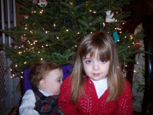 Retro picture of Skylar and Alyssa probably around time Alyssa's stage rush occurred. Note presence of a gate around tree. Autism+gate can often=friends