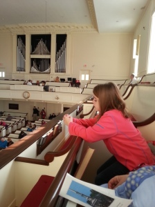 Skylar paying close attention to the Reverend's words. She would prove this later.