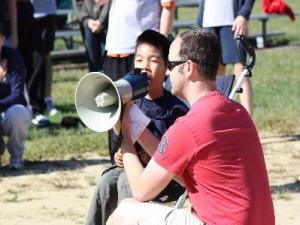 Rich holding the bullhorn so Justin can sing the National Anthem in the pre-Miracle Field days. Anyone who attended the Diamond 5K this past Sunday discovered what anyone who has attended a Miracle League game has known for years: nobody can sing like Justin!